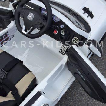 Электромобиль Mercedes-Benz SLS AMG белый (колеса резина, сиденье кожа, пульт, музыка, электроусилитель)